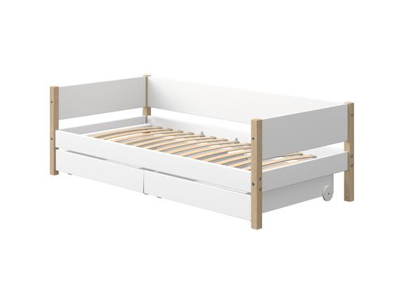 Łóżko NOR z dębowymi nogami i MDF z 2 szufladami na miękkich kółkach.